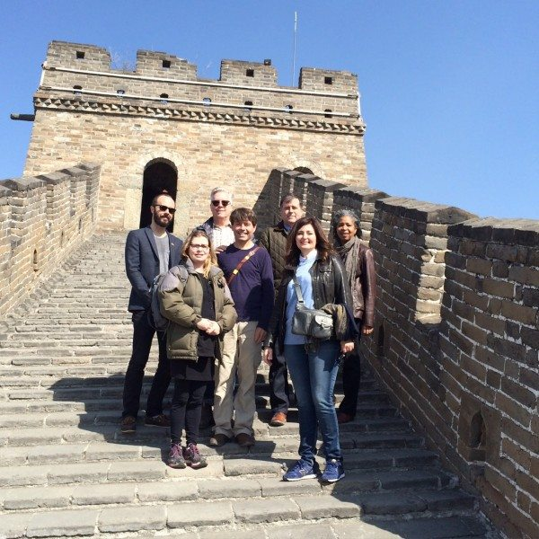 Andy McGuire, Ricky Mugford, Geoffrey Taylor, Dionne Brand. Front: Anakana Schofield, Michael Crummey, and Christine Saratsiotis atop the Great Wall of China.